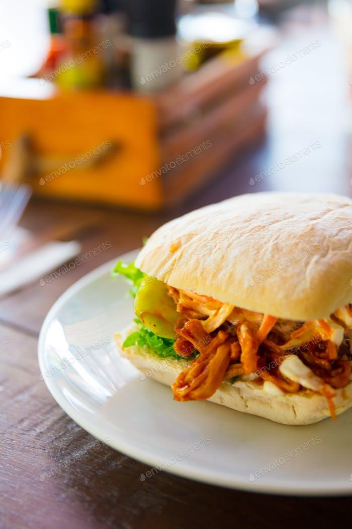 Fresh Pulled Pork Burger Served On Restaurant Table