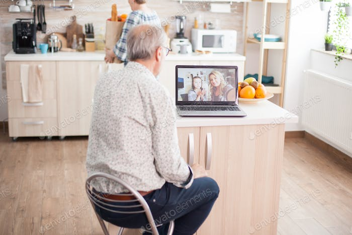 Senior man talking with niece on video call