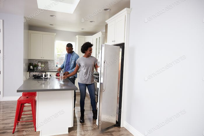 Young Couple Relaxing In Apartment Kitchen Together