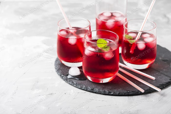 Red alcoholic coctail with ice and mint