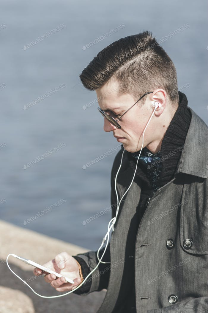 Handsome Young Man Listening To Music