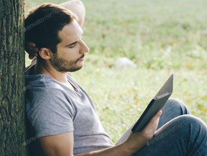 Man reading e book reader