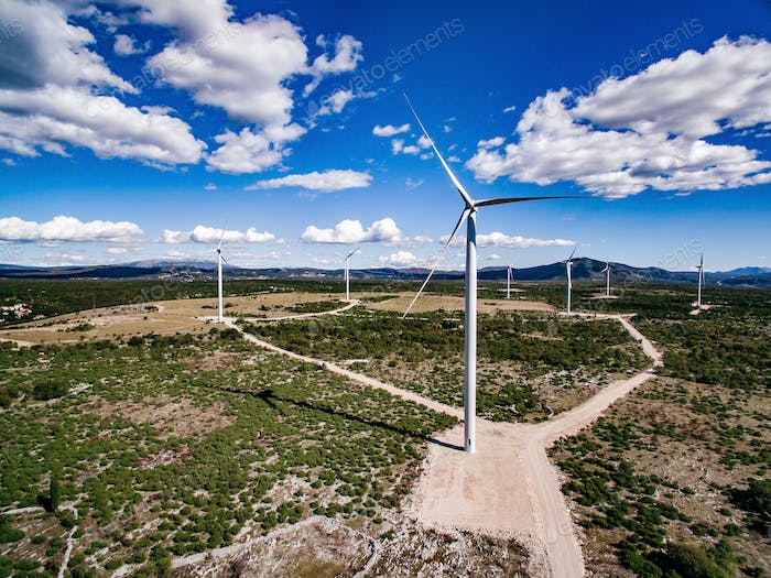Wind turbines or windmills in desert landscape in Greece