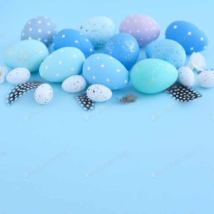 Easter eggs on blue background with empty space. Easter card