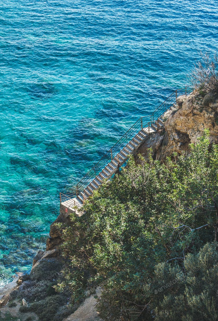 Stairs leading down to lagoon and turquoise sea waters, Turkey