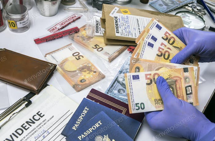 American passport and money of a evidence bag in laboratory of criminology, conceptual image