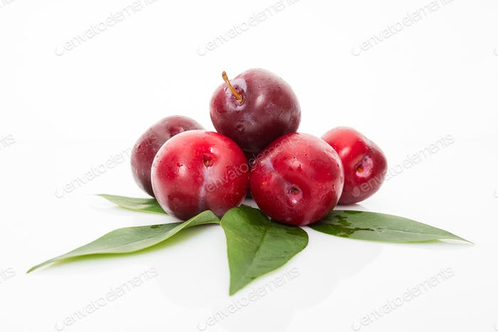 fresh plum isolated on white background