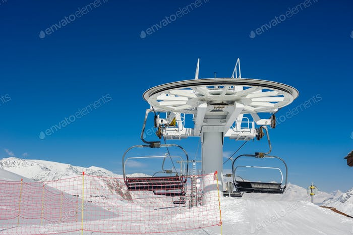 Ski lift in mountains at winter