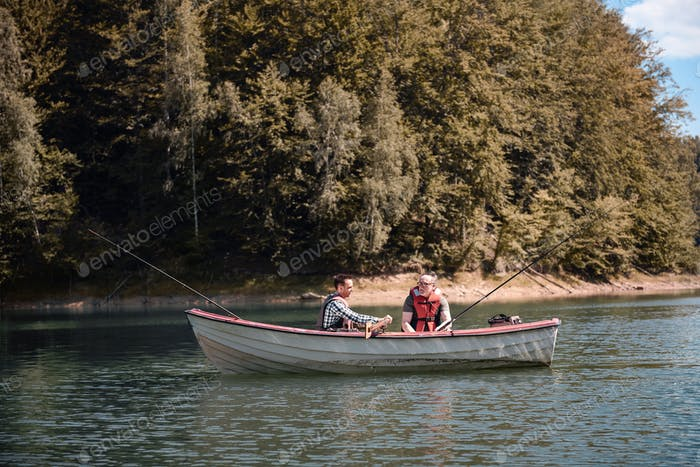 Men fishing in a calm lake from boat