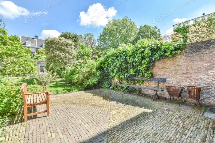 Cozy patio of house with cobblestone