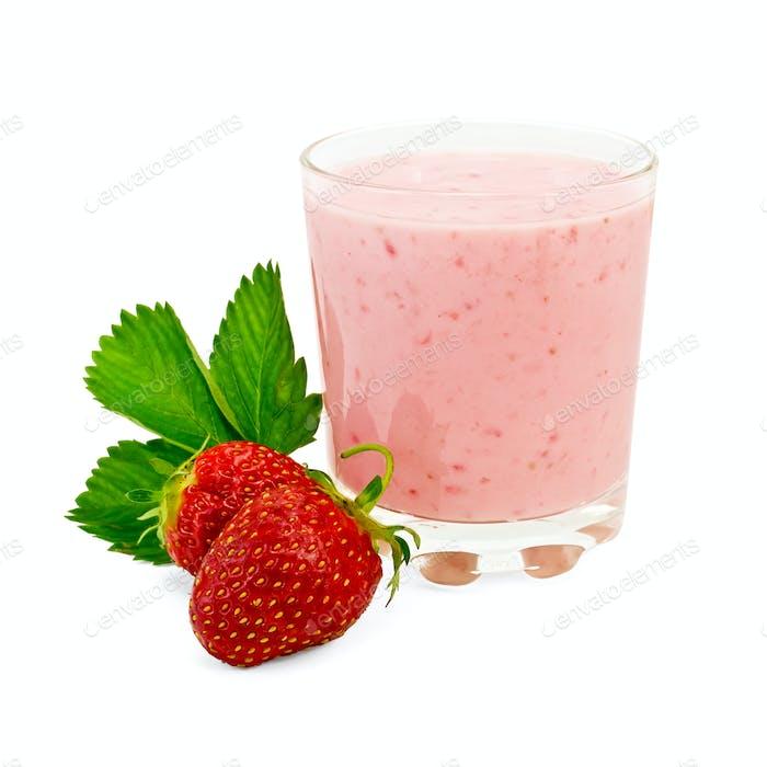 Milkshake with strawberry and a leaf