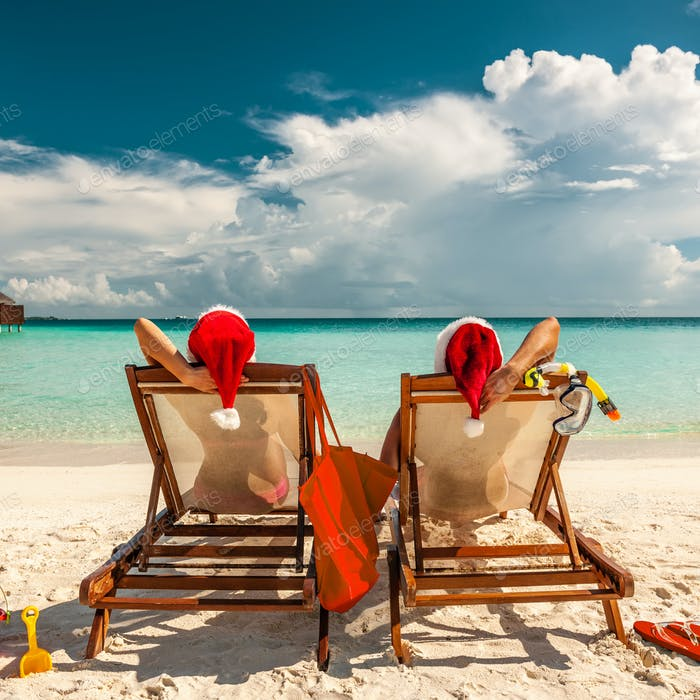 Christmas Beach.Couple On A Beach At Christmas Photo By Haveseen On Envato