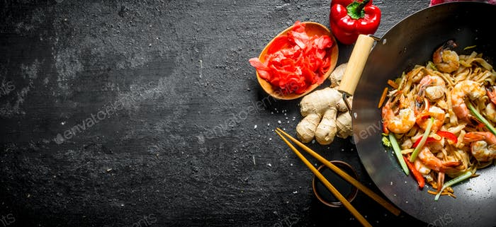 Wok Udon noodles with ginger, soy sauce and bell pepper.