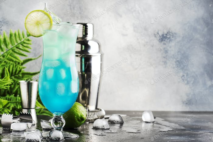 Blue Hawaiian or Blue Lagoon alcoholic cocktail with vodka, liqueur, tonic, pineapple juice and ice