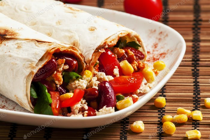 Traditional Mexican food, burritos with meat and beans