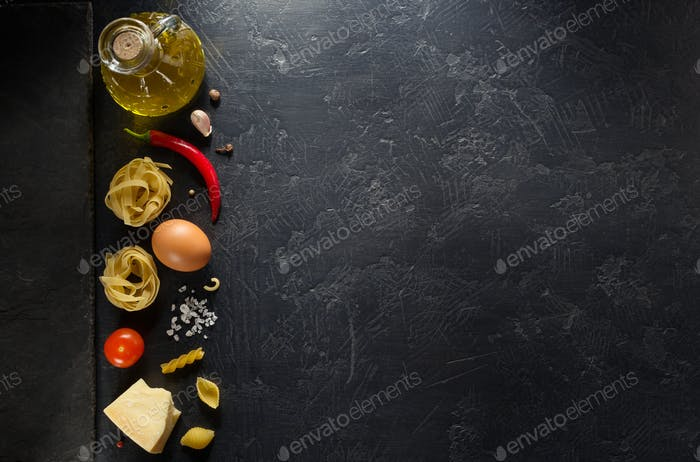 pasta ingredients on black background