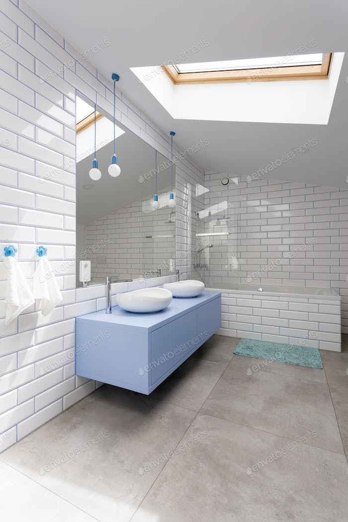 Bathroom with white brick wall