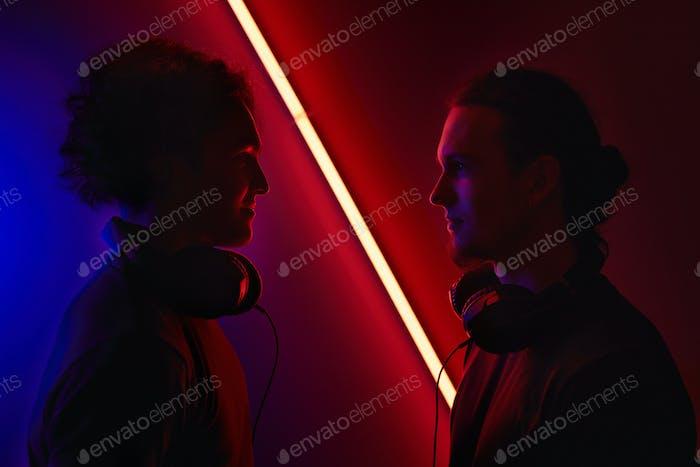 Two gamers in dark room