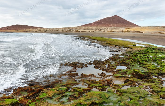El Medano beach with red mountain at background, Tenerife, Canary Islands, Spain