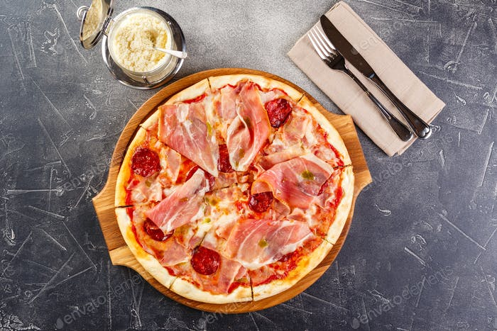 Pizza with salami and prosciutto