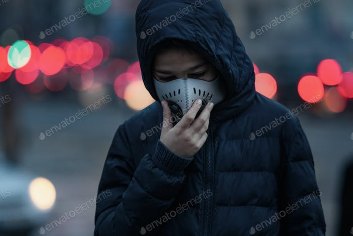 Child with Air Pollution Mask, Traffic in the Background