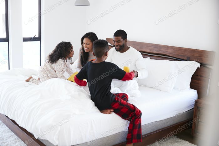 Children Bringing Parents Breakfast In Bed To Celebrate Mothers Day Fathers Day Or Birthday