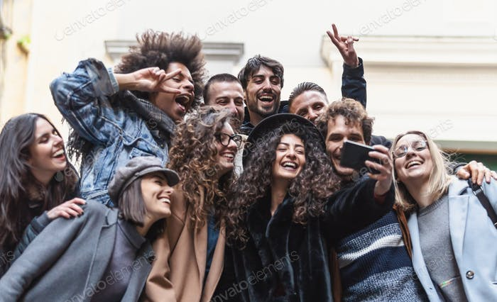 Young people taking selfie with mobile smartphone outdoor
