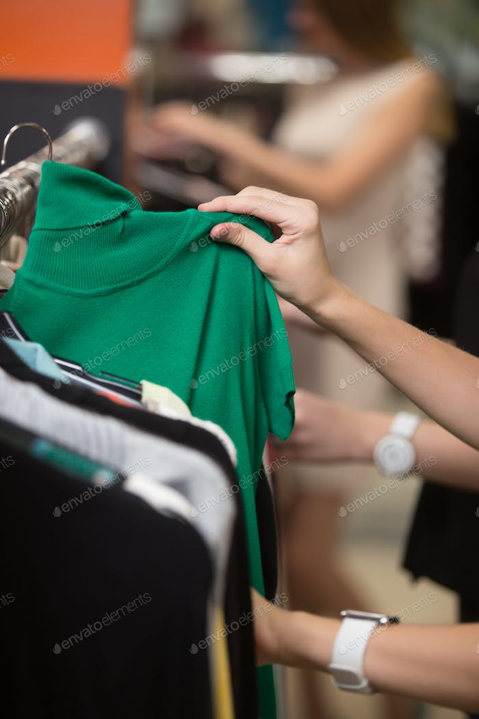 Choosing green turtleneck, closeup