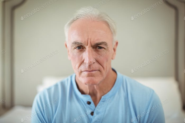 Worried senior man sitting at home