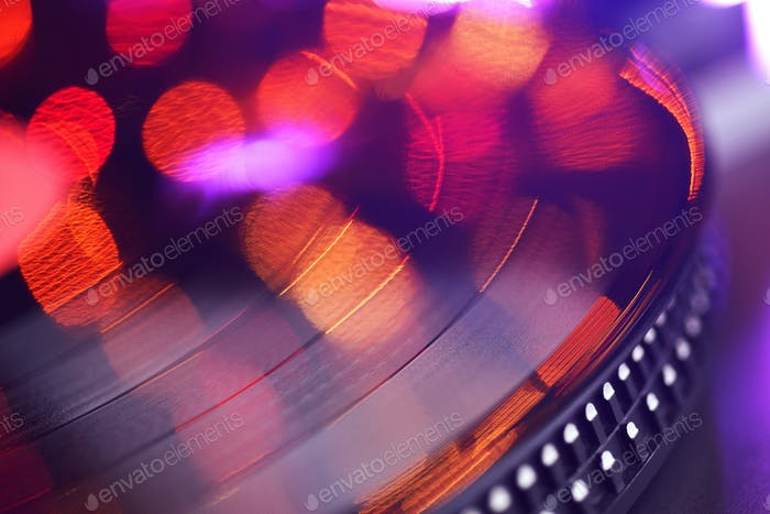 Vinyl player LP record with blured or defocused lights.