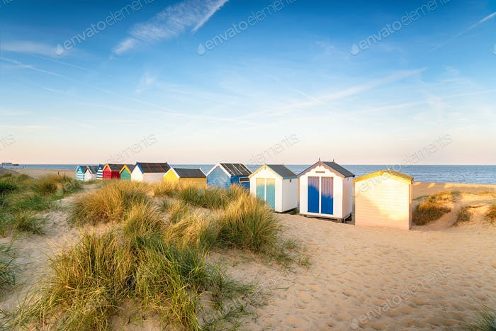 Colourfull beach huts in the sand dunes at Southwold