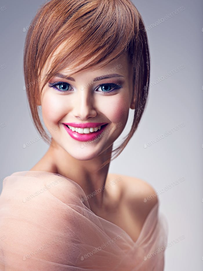 Beautiful smiling redhead girl with style hairstyle.