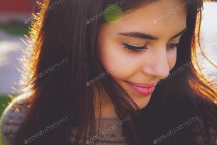 Closeup portrait of a happy cute woman