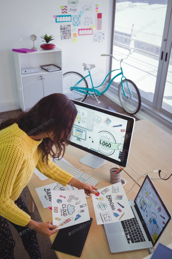 Female graphic designer working at office desk