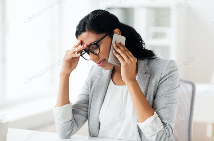 stressed businesswoman with smartphone at office