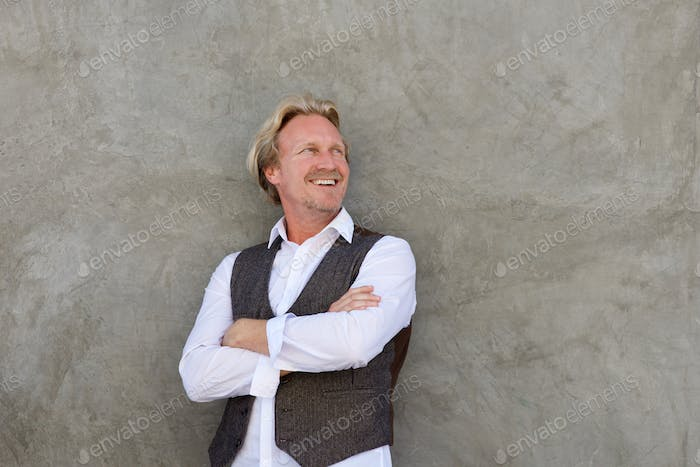 handsome middle aged man smiling and looking away