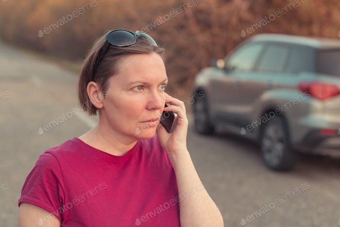 Woman lost during car driving talking on mobile phone
