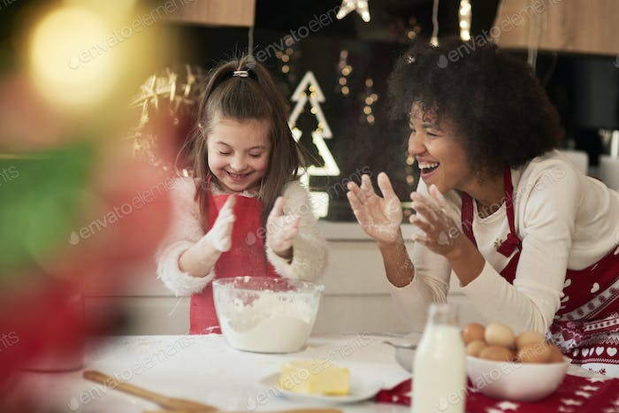 Mom and daughter playing with flour