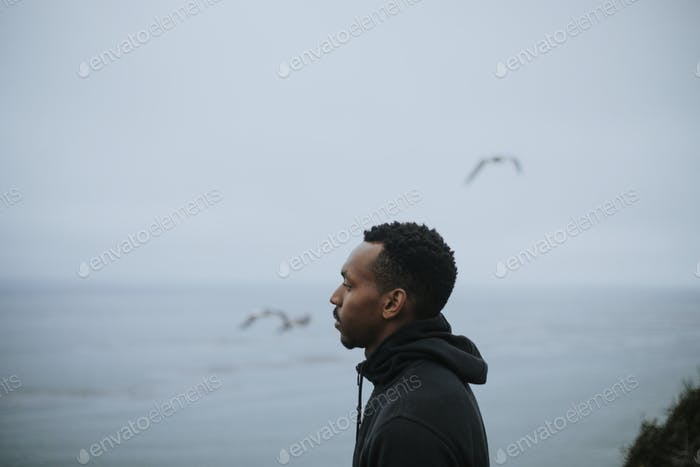 Side view portrait of a man by the water