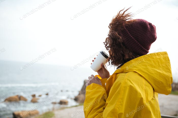 Woman looking at sea in fall