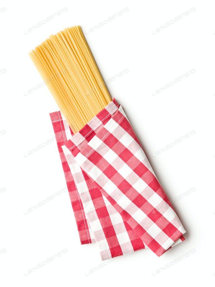Uncooked spaghetti pasta.