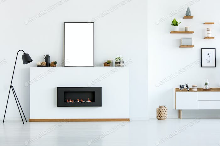 Black lamp next to fireplace in white living room interior with