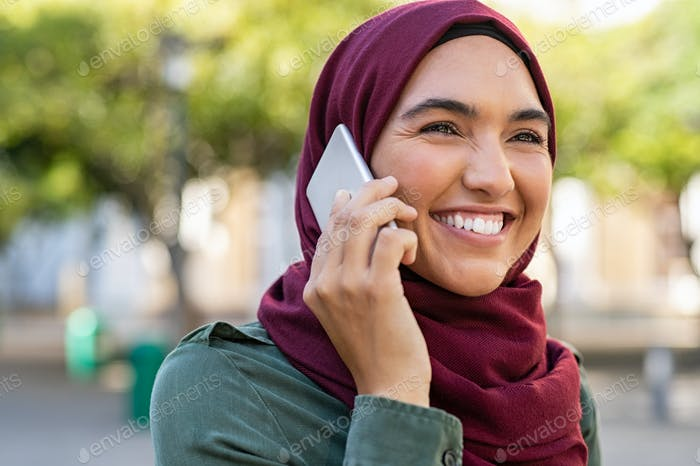 Muslim young woman talking on phone