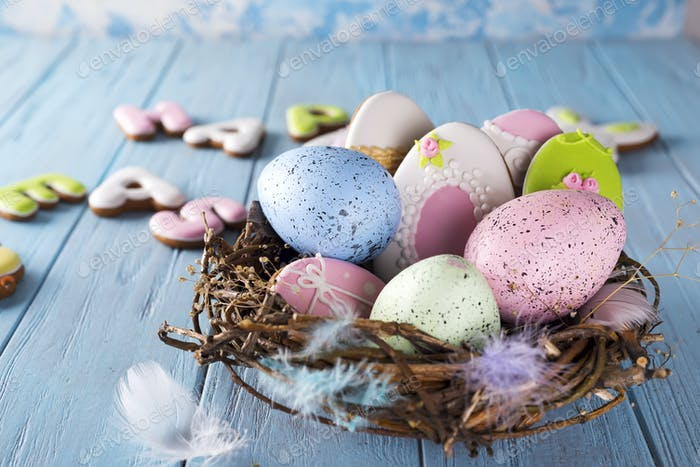 Colorful easter egg in the nest on wood background