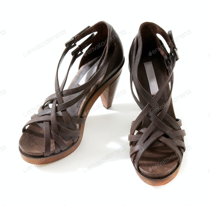 Wooden high heeled brown leather sandals pair