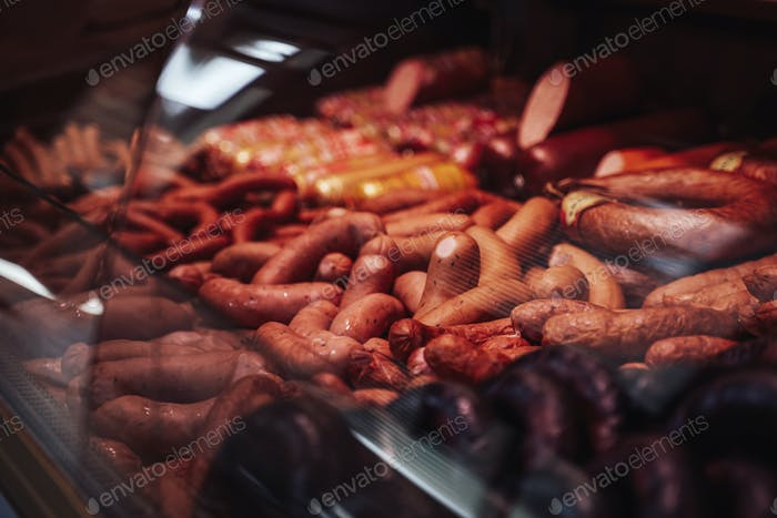 Many of cool sausages in the fridgerator