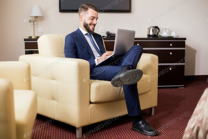 Handsome Businessman Enjoying Hotel Stay
