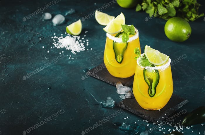 Spicy margarita cocktail with tequila, mango juice, jalapeno pepper, lime and salt