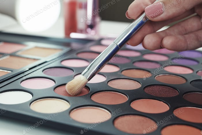Woman choosing brown shadow