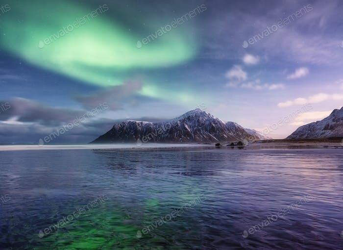 Norther lights, Senja island, Norway. Landscape at the night time